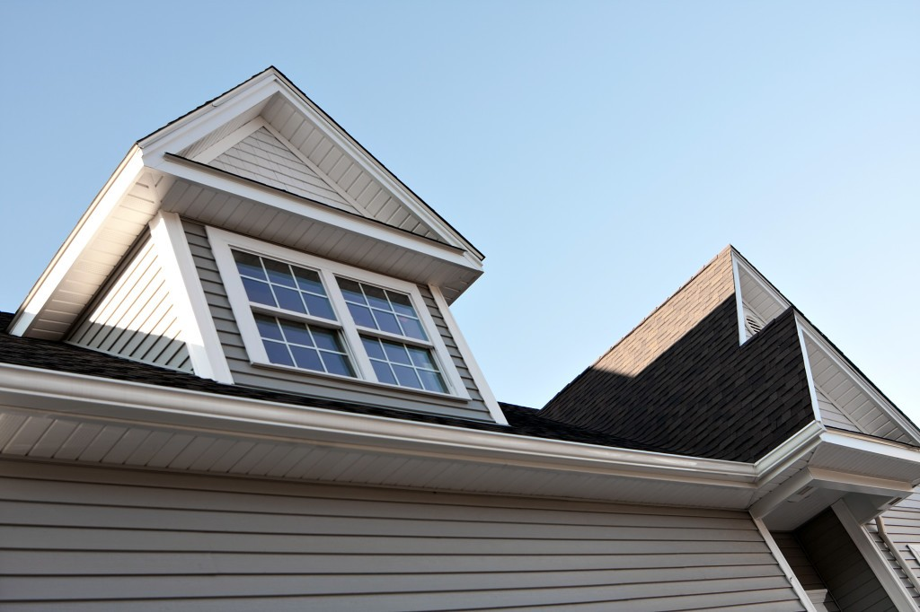 Close up view of a newly built house rooftop soffit and dormers.